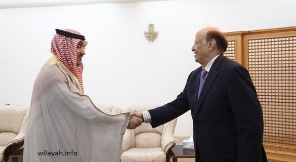 Yemen's President Abd-Rabbu Mansour Hadi shakes hands with Saudi Arabia's ambassador to Yemen Mohammed Said al-Jaber ahead of a meeting in the southern port city of Aden