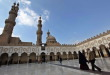 Muslim walk at Al Azhar mosque in the old city of Cairo