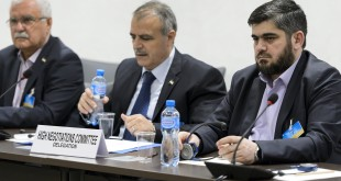 Members of the Syrian opposition delegation of the HNC attend a meeting in Geneva