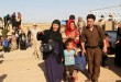 Sunni Muslims who fled the Islamic State's strongholds of Hawija arrive on the outskirts of Kirkuk