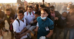Wounded Palestinian demonstrator is evacuated during clashes with Israeli troops at the Israel-Gaza border in the southern Gaza Strip